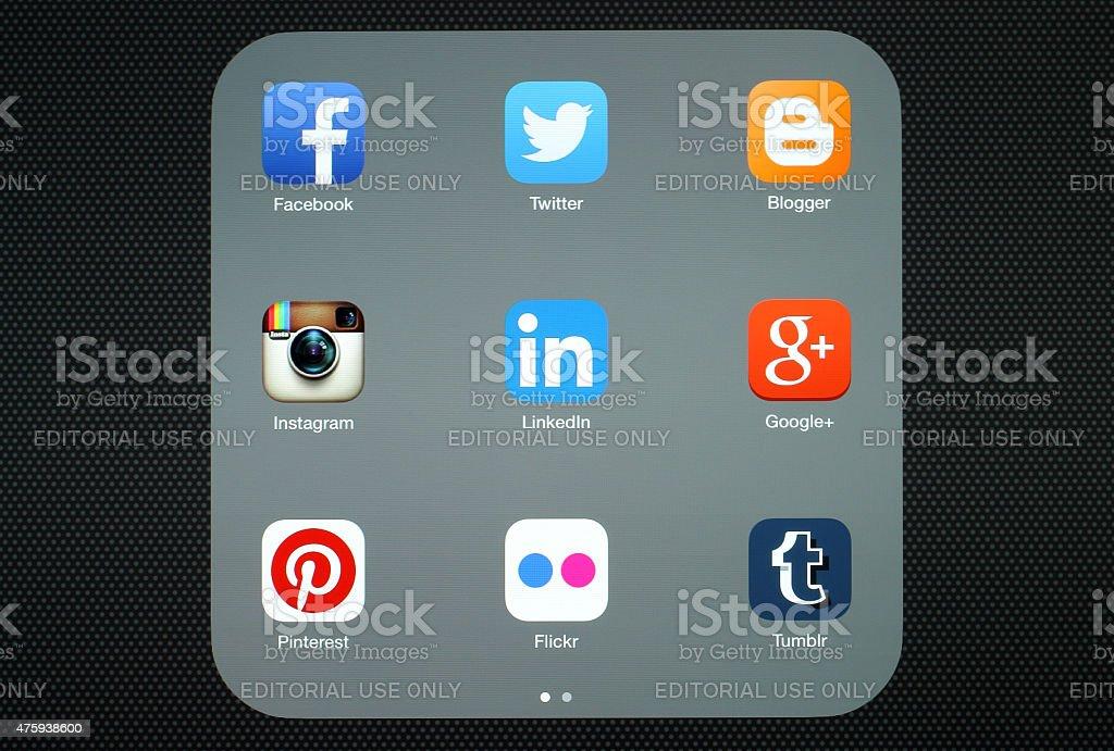 Collection of popular social media logos on iPad screen stock photo