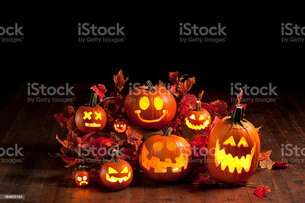 A collection of several Halloween jack-o-lanterns stock photo