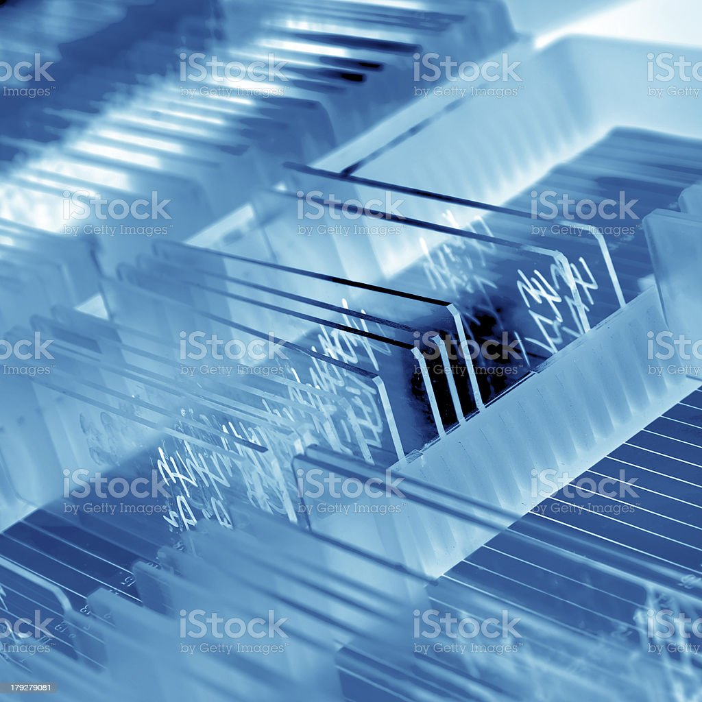 A collection of small glass microscope slides stock photo