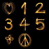 Collection of sparkler firework light alphabet number and sign.