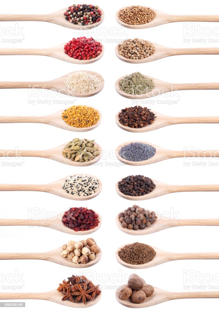 Collection of spices on wooden spoons. stock photo