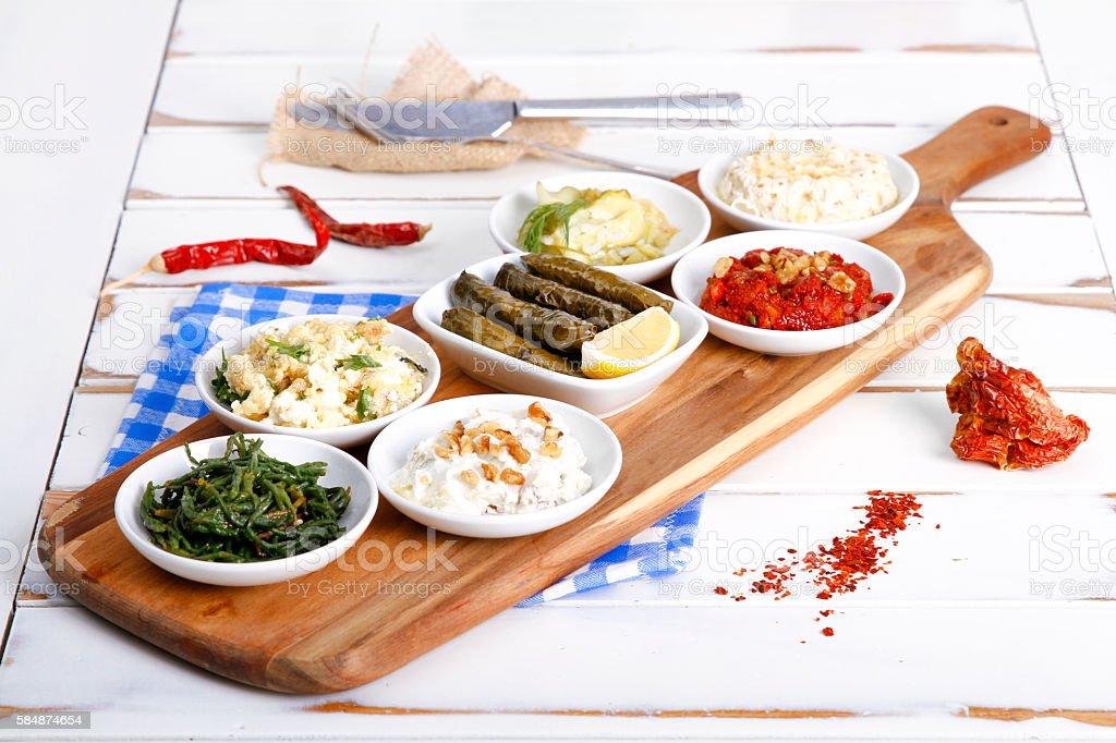 Collection of tapas foods including dates, yogurt, sarma, fresh mozzarella stock photo