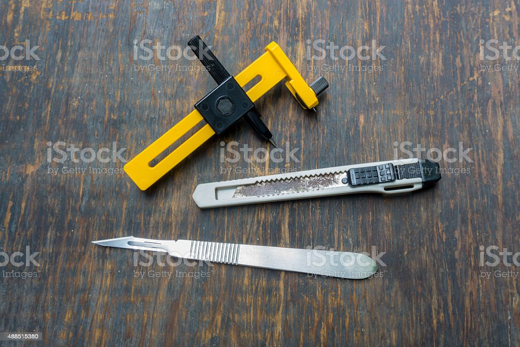 Collection of tools drawing isolated on wood background stock photo