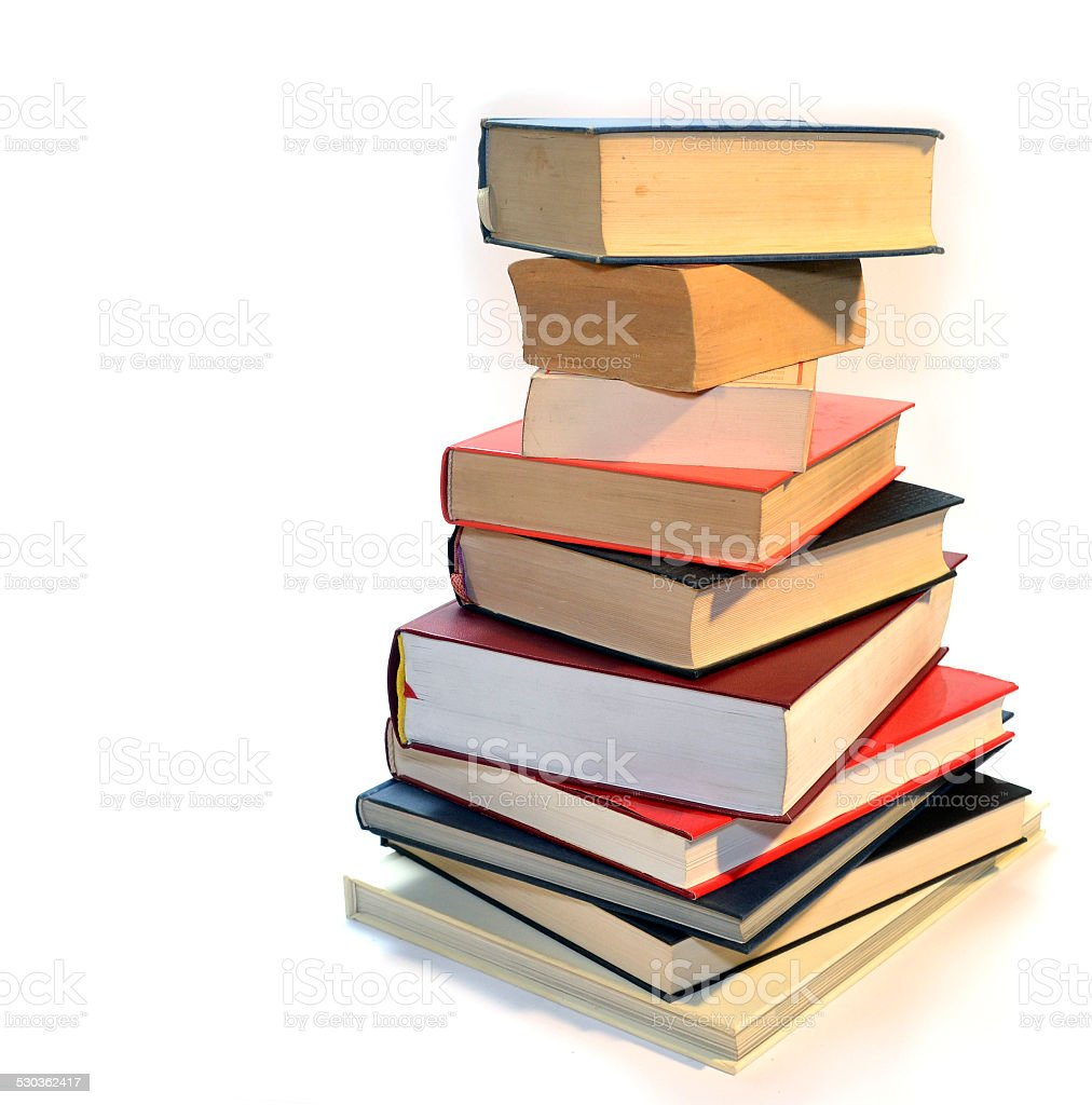 collection of various books in different colors stock photo