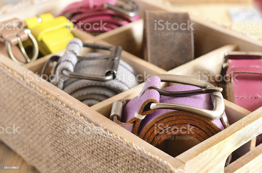 Collection of vintage belts in wooden crate royalty-free stock photo