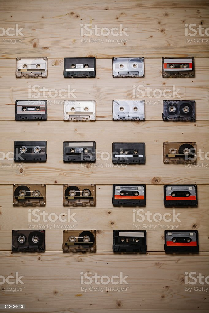 Collection of vintage Compact Cassettes on Wooden background stock photo