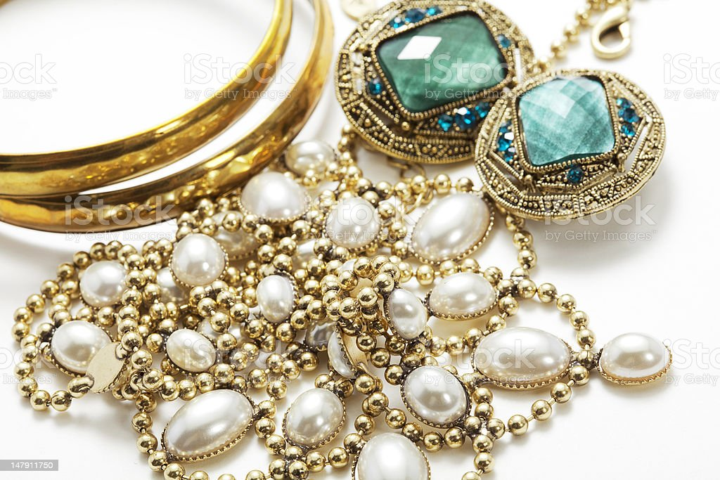 Collection of vintage jewelry on white surface stock photo