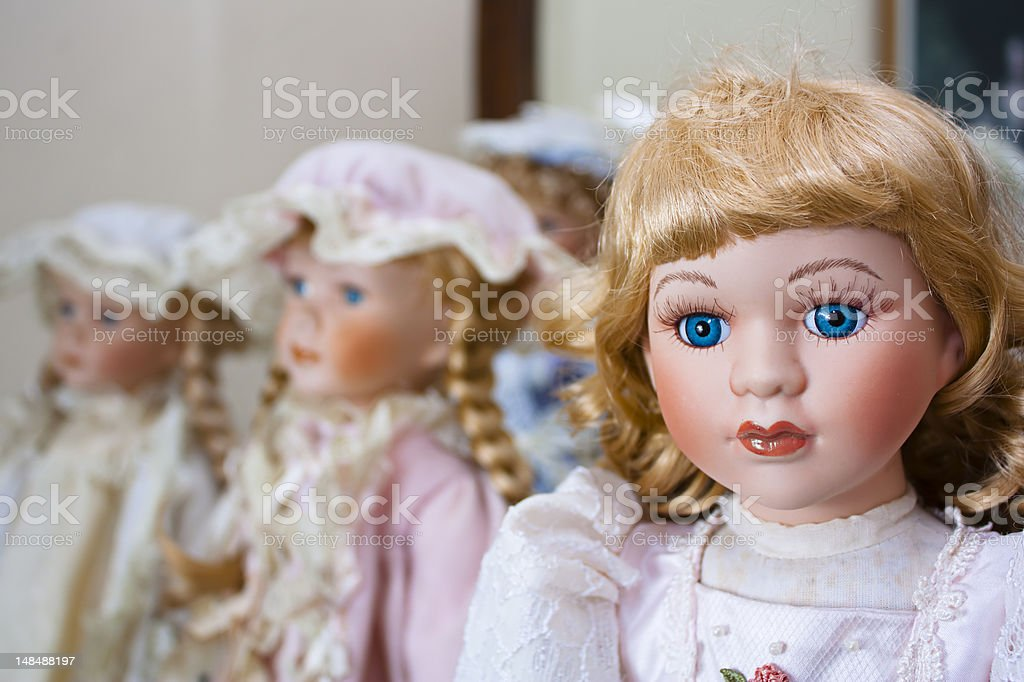 Collection of vintage porcelain dolls stock photo