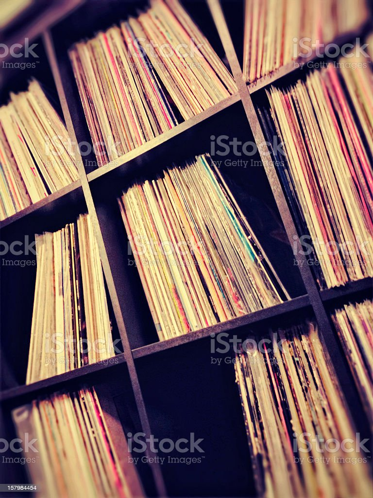 Collection of vinyl records on shelves stock photo