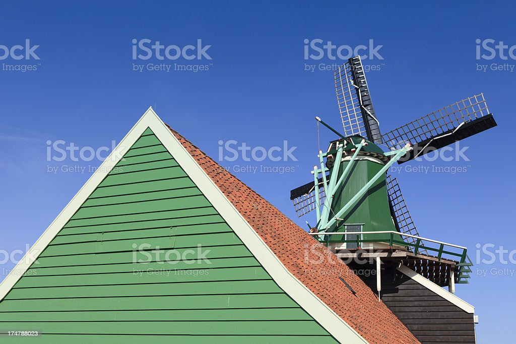 collection of well-preserved historic windmills and houses at Za royalty-free stock photo