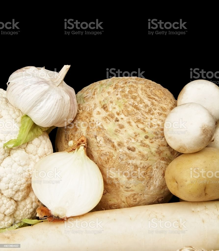 Collection of white vegetables on black bottom view stock photo