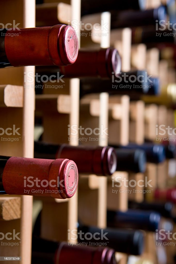 Collection of wine bottles in cellar royalty-free stock photo