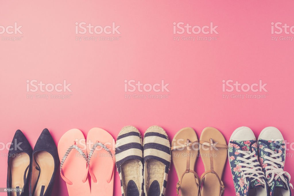 Collection of women's shoes on pink background stock photo