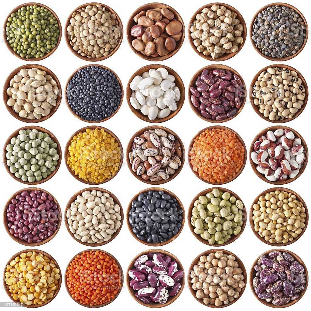 collection of wooden bowls with legumes stock photo