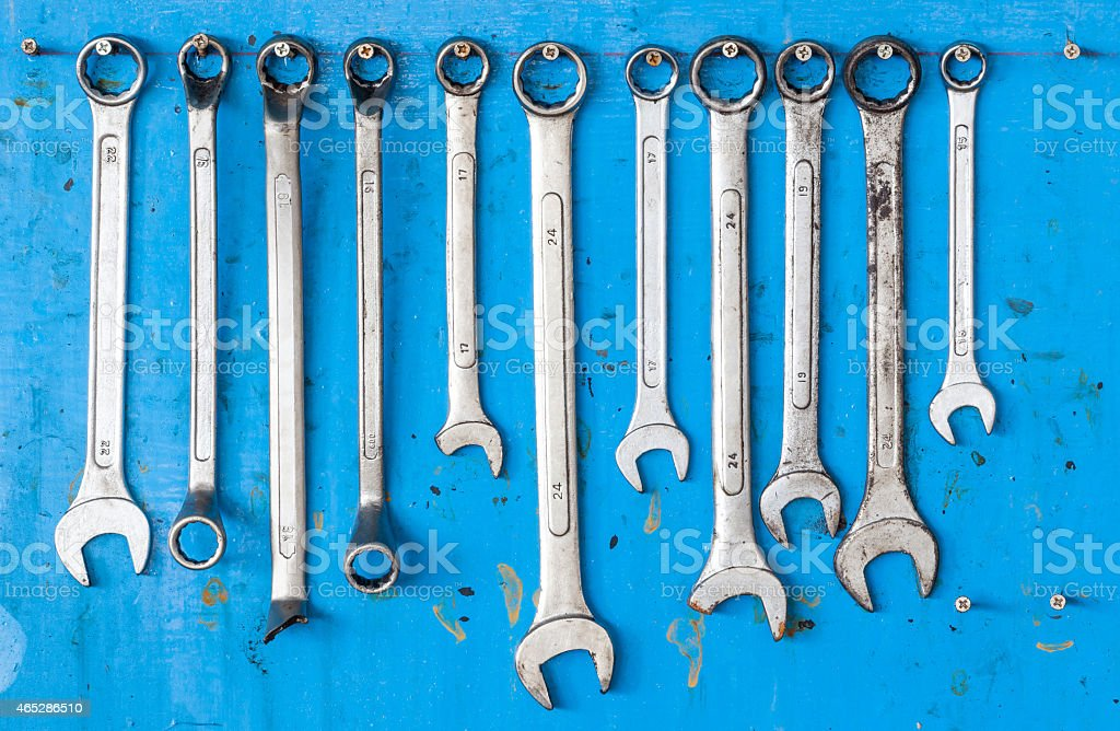 Collection of wrench on a grunge blue background stock photo