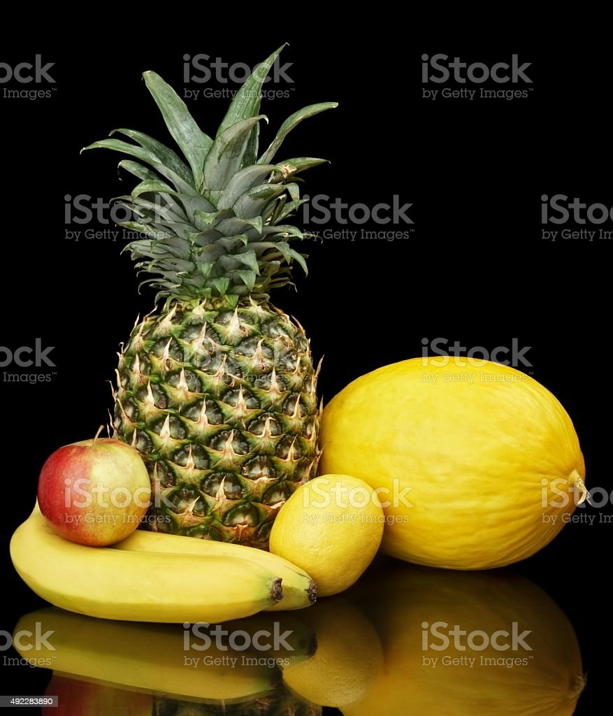 Collection of yellow fruits on black stock photo