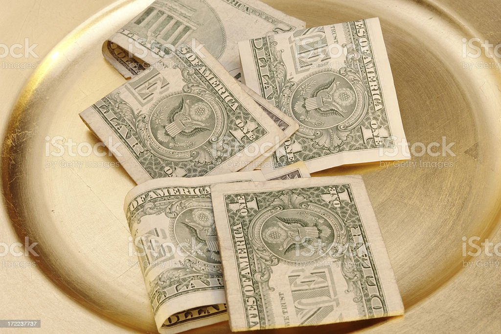 Collection Plate with Money stock photo