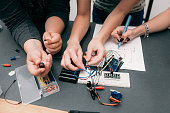 Collective electronics development with scheme