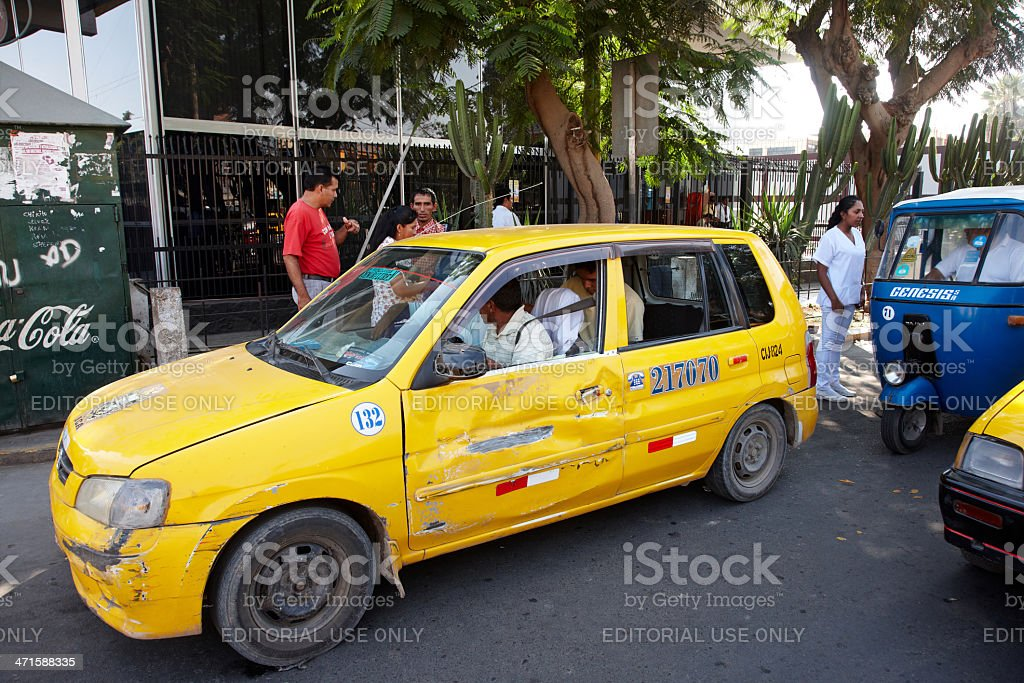 Collectivo taxi and tuktuks in Peruvian street royalty-free stock photo