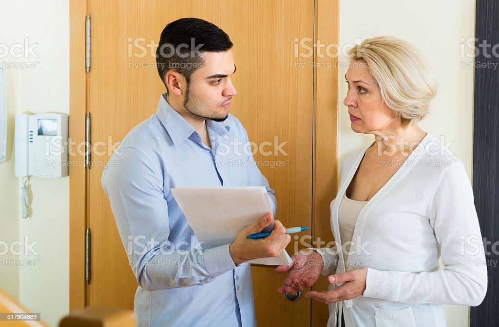 Collector and housewife near the door stock photo