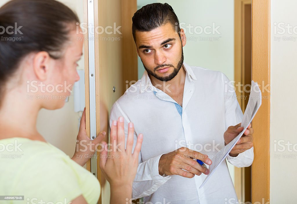 collector is trying to get the debts from  woman stock photo