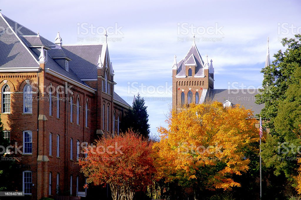 College campus during fall with changing trees stock photo