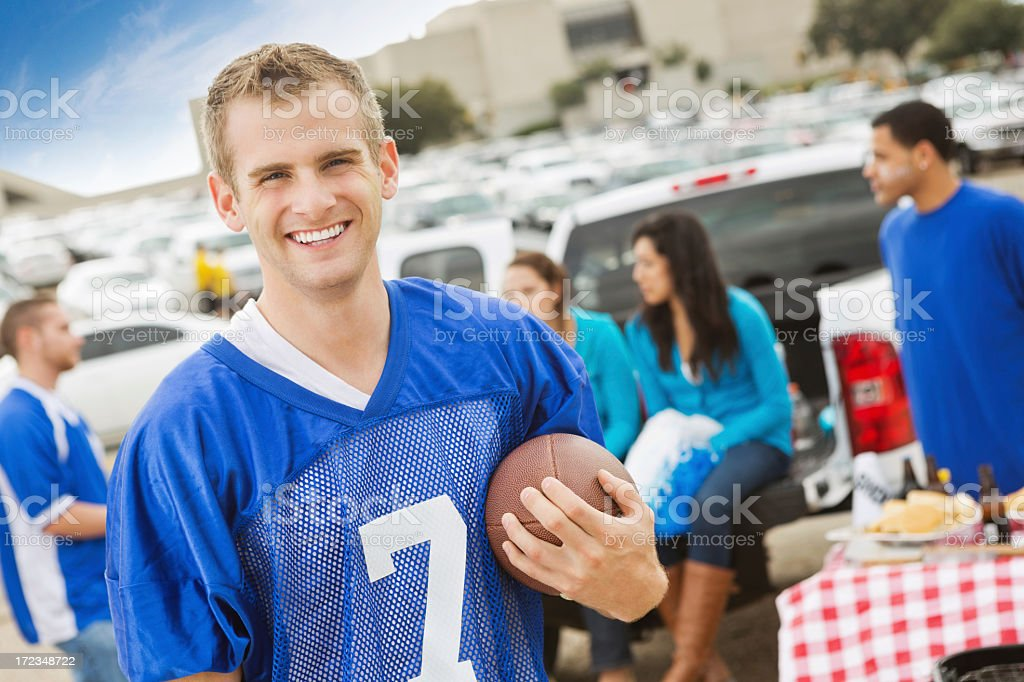 College football fan at stadium tailgate party with friends stock photo