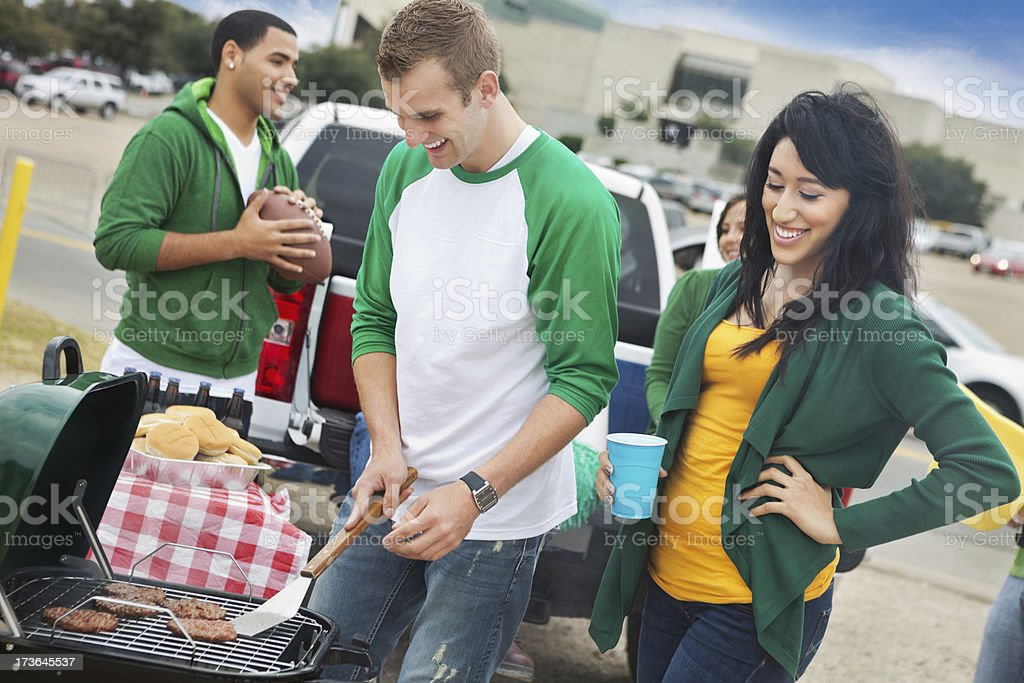 College football fans grilling/tailgating at stadium stock photo