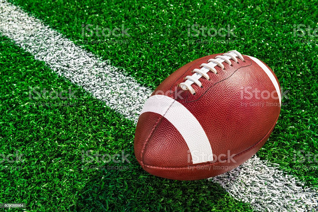 College football sitting on yard line stock photo