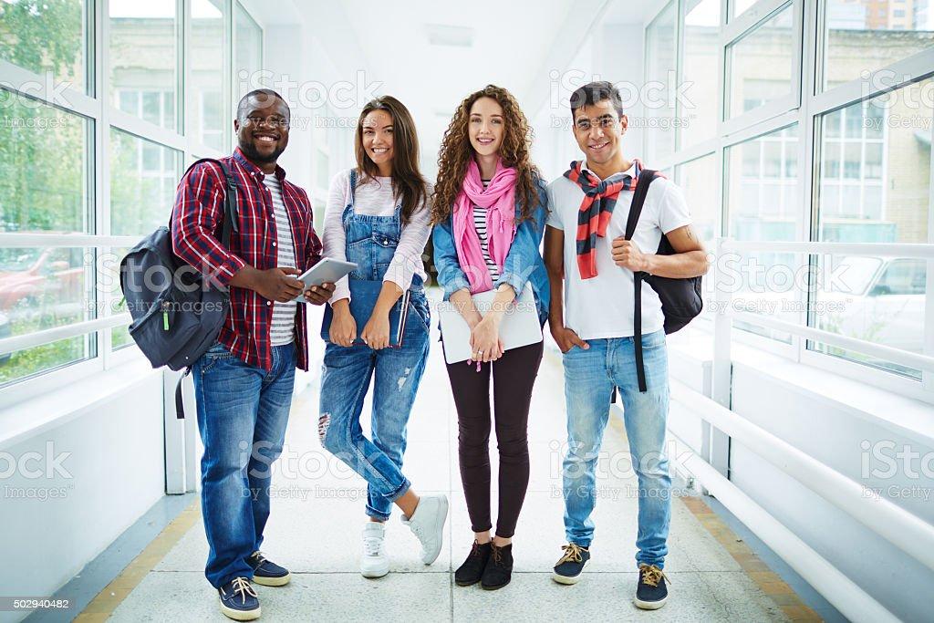 College friends in corridor stock photo