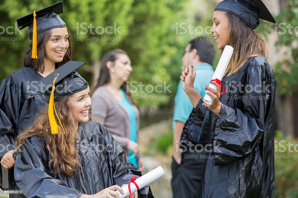 College friends talk after graduation stock photo