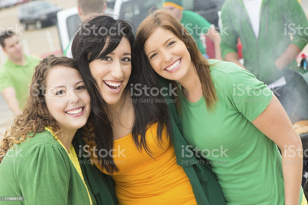 College girl friends posing together at tailgate party royalty-free stock photo