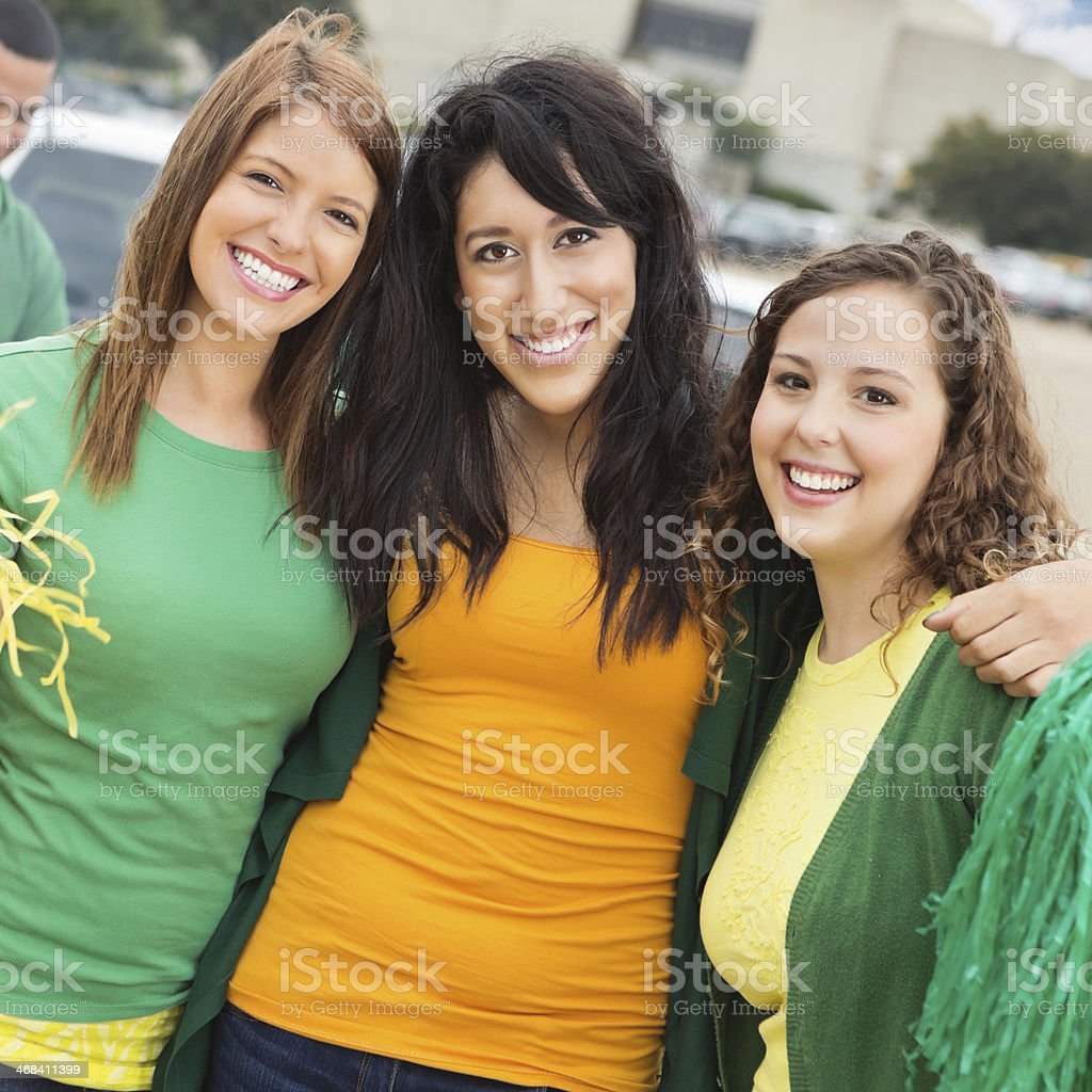 College girlfriends tailgating at football stadium together royalty-free stock photo