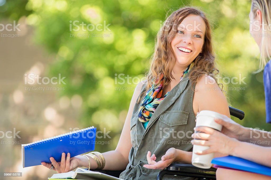 College girls talk before class on campus stock photo