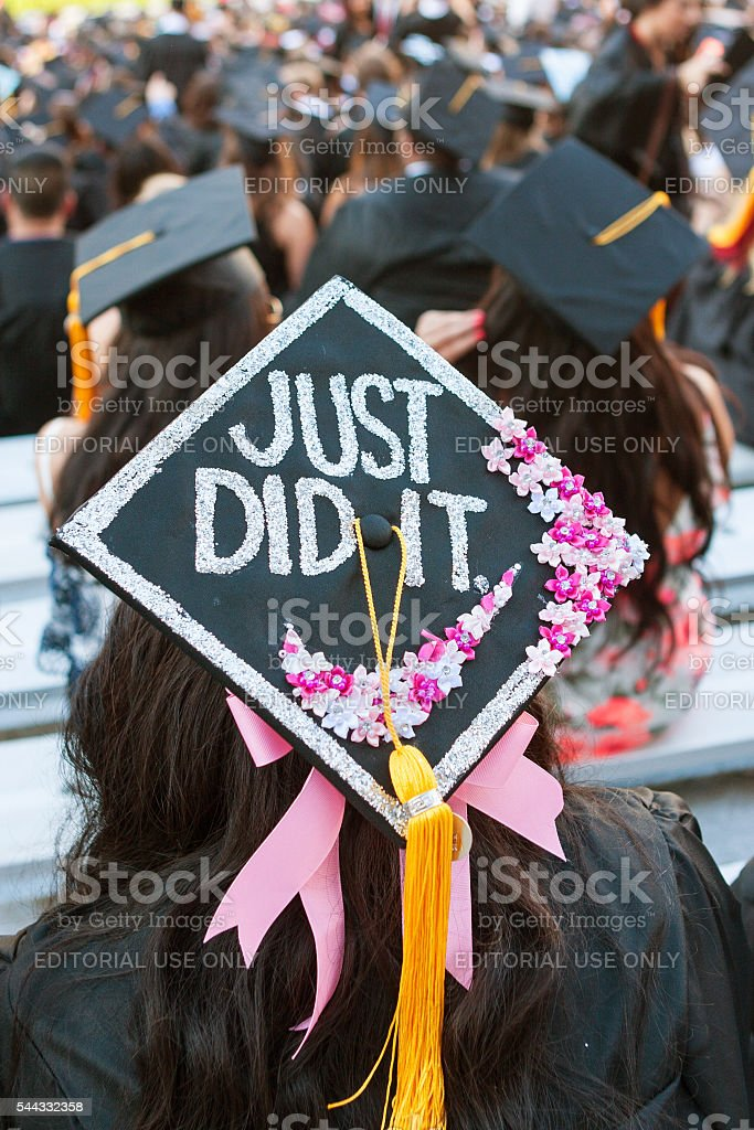 College Graduate Has Special Message On Top Of Mortar Board stock photo