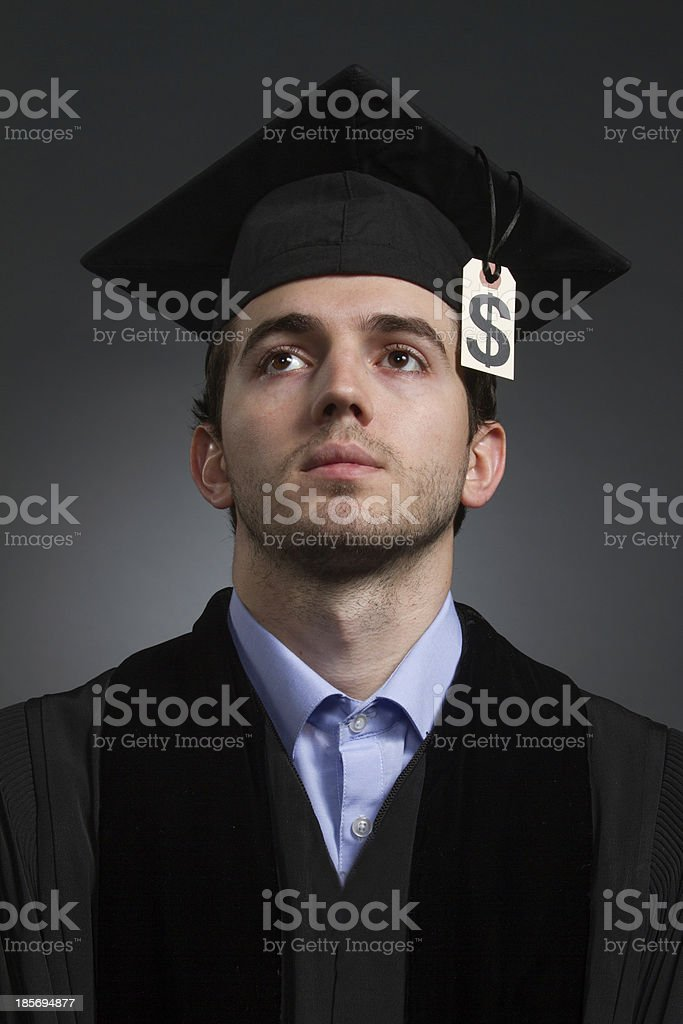 College graduate with tuition price tag, vertical royalty-free stock photo