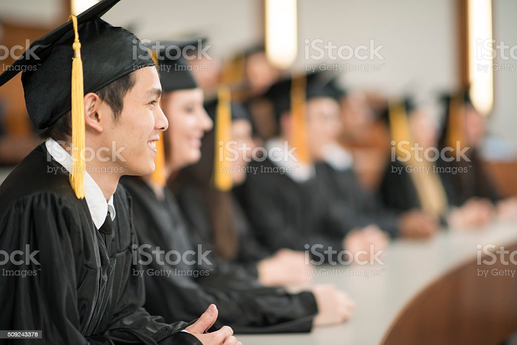 College Graduates Sitting in a Row stock photo