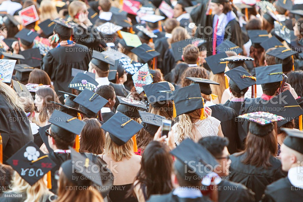 College Graduates Wearing Mortarboards Gather For Graduation Activities stock photo