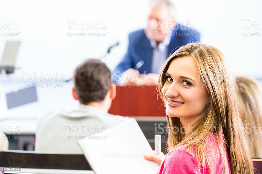 College professor giving lecture for students stock photo