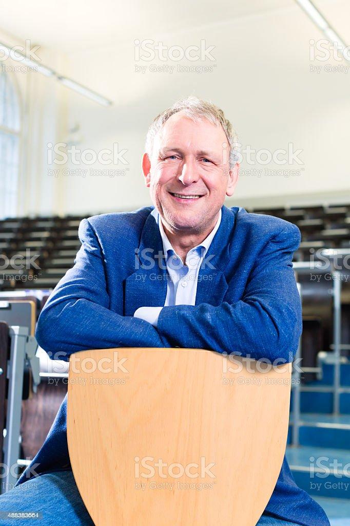 College professor in auditorium stock photo