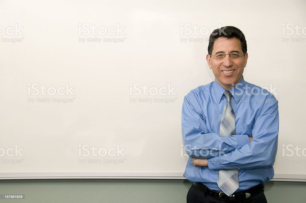 College Professor Standing in Front of a White Board royalty-free stock photo
