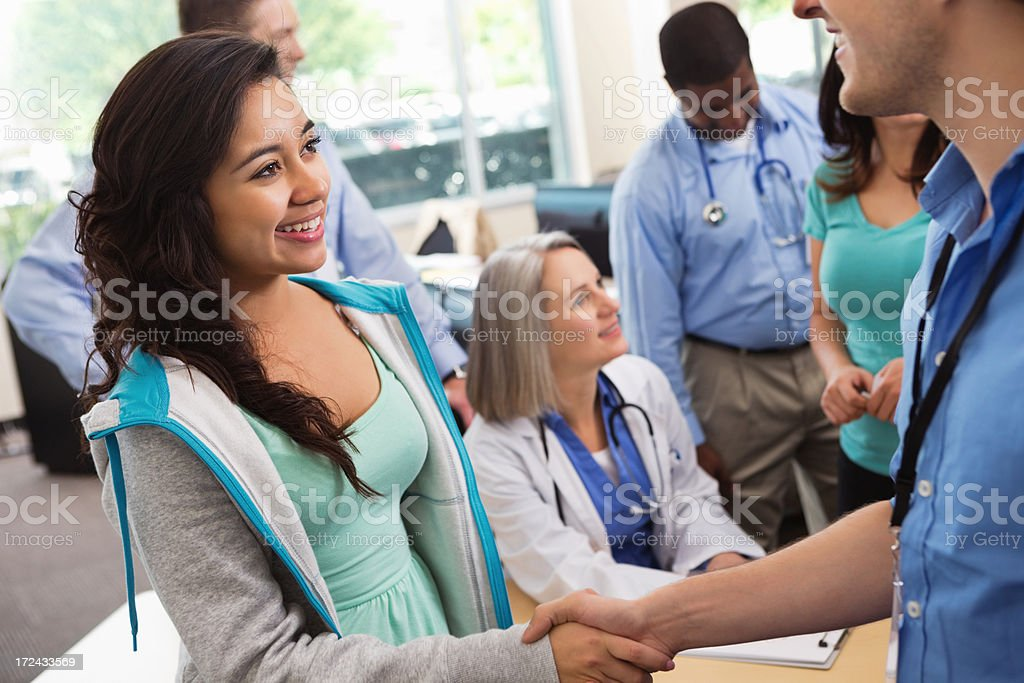 College student attending medical or nursing seminar in lecture hall royalty-free stock photo