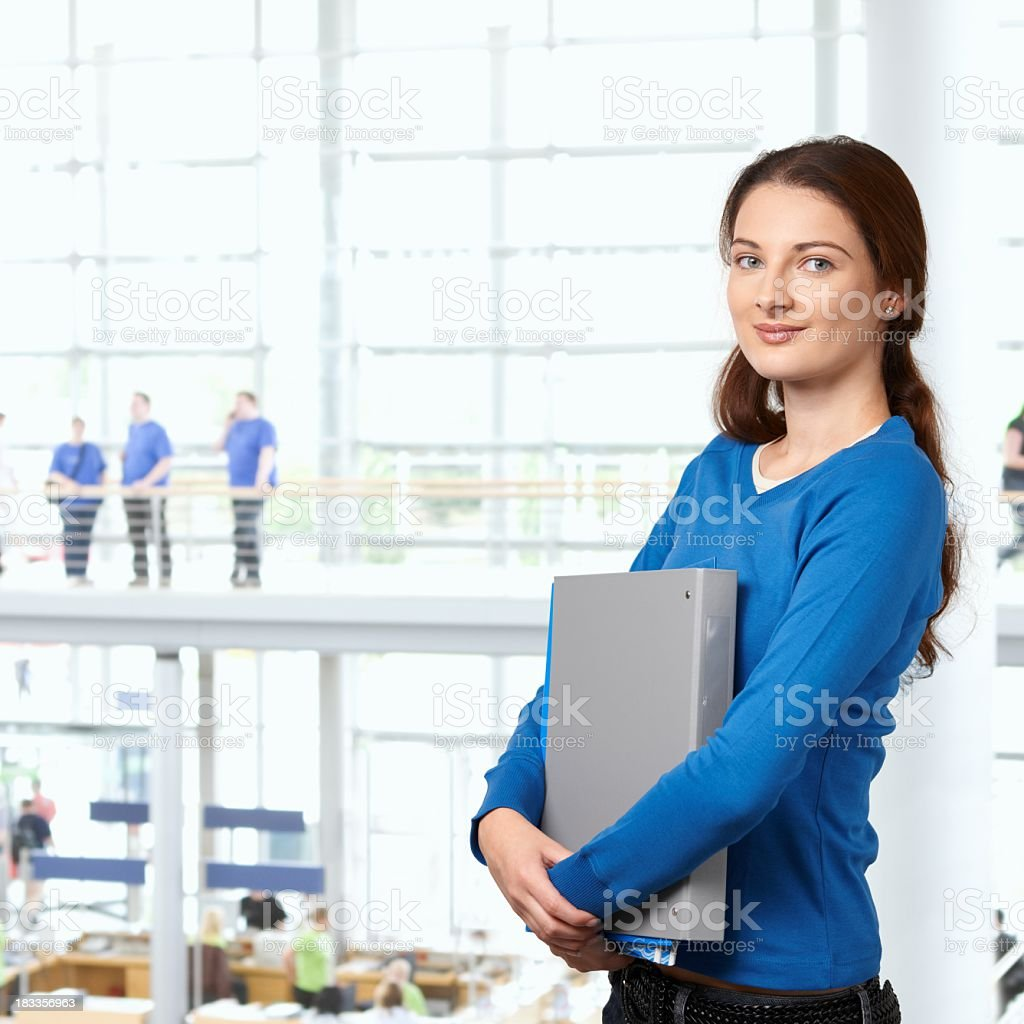 College student girl in library lobby royalty-free stock photo