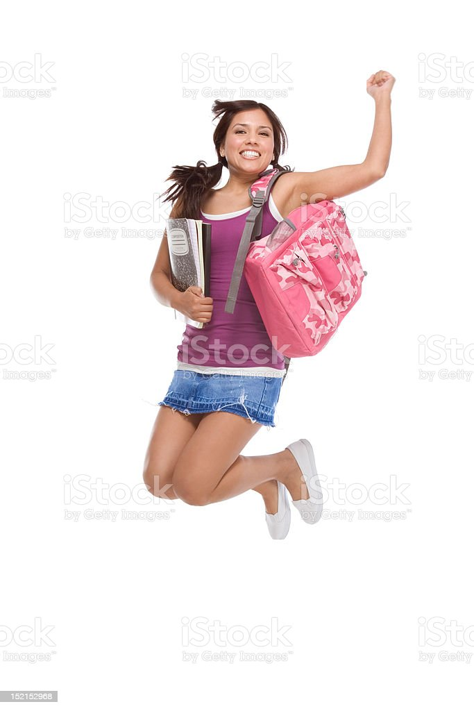 College student Hispanic teen with backpack jumping royalty-free stock photo