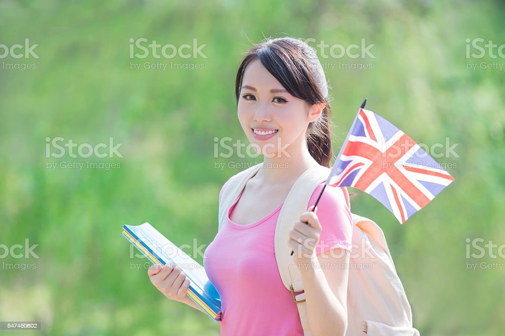college student hold British flag stock photo