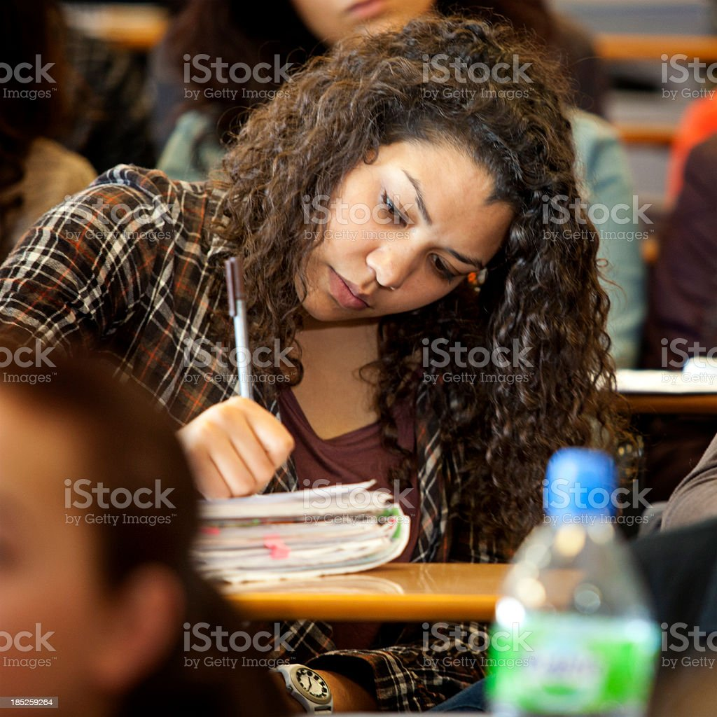 College student in lecture hall royalty-free stock photo