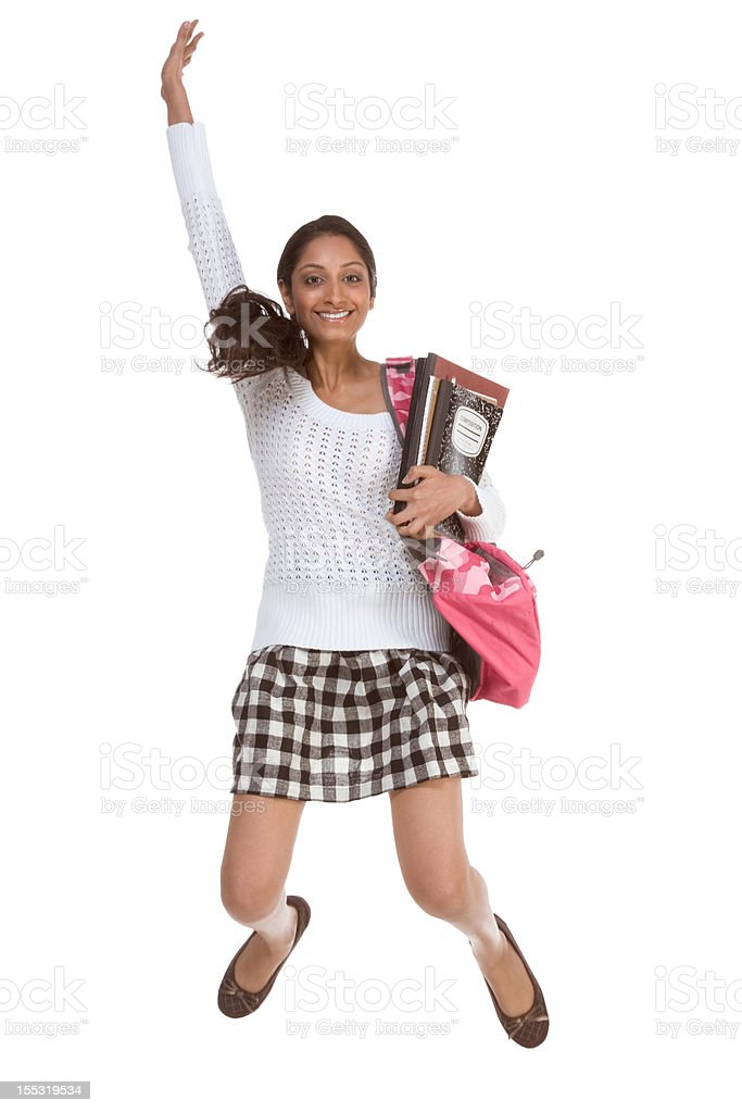 College student Indian teen with backpack jumping royalty-free stock photo
