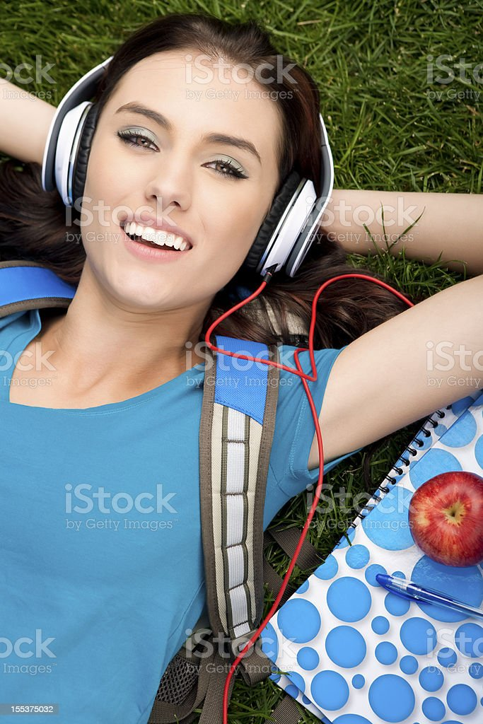 College student laying on grass royalty-free stock photo