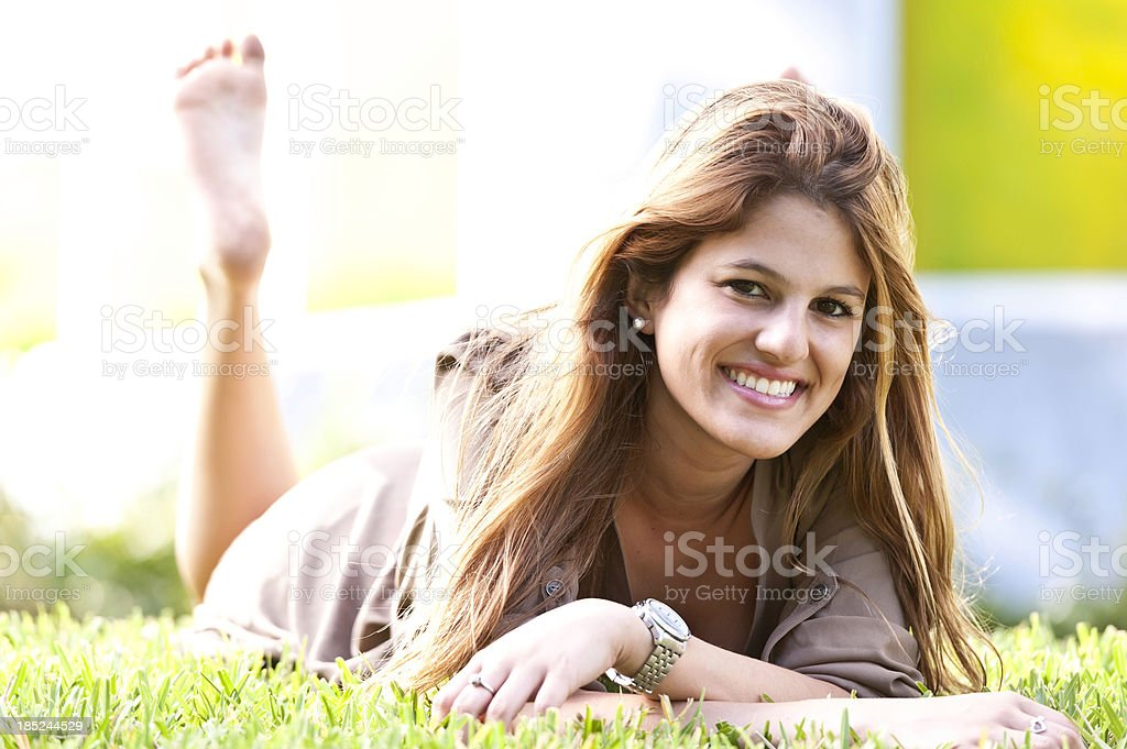 College Student Lying on the Grass royalty-free stock photo