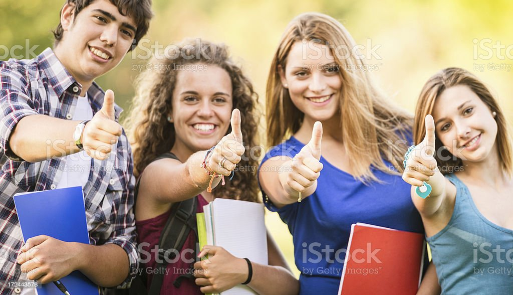 College student on a campus - thumbs up royalty-free stock photo